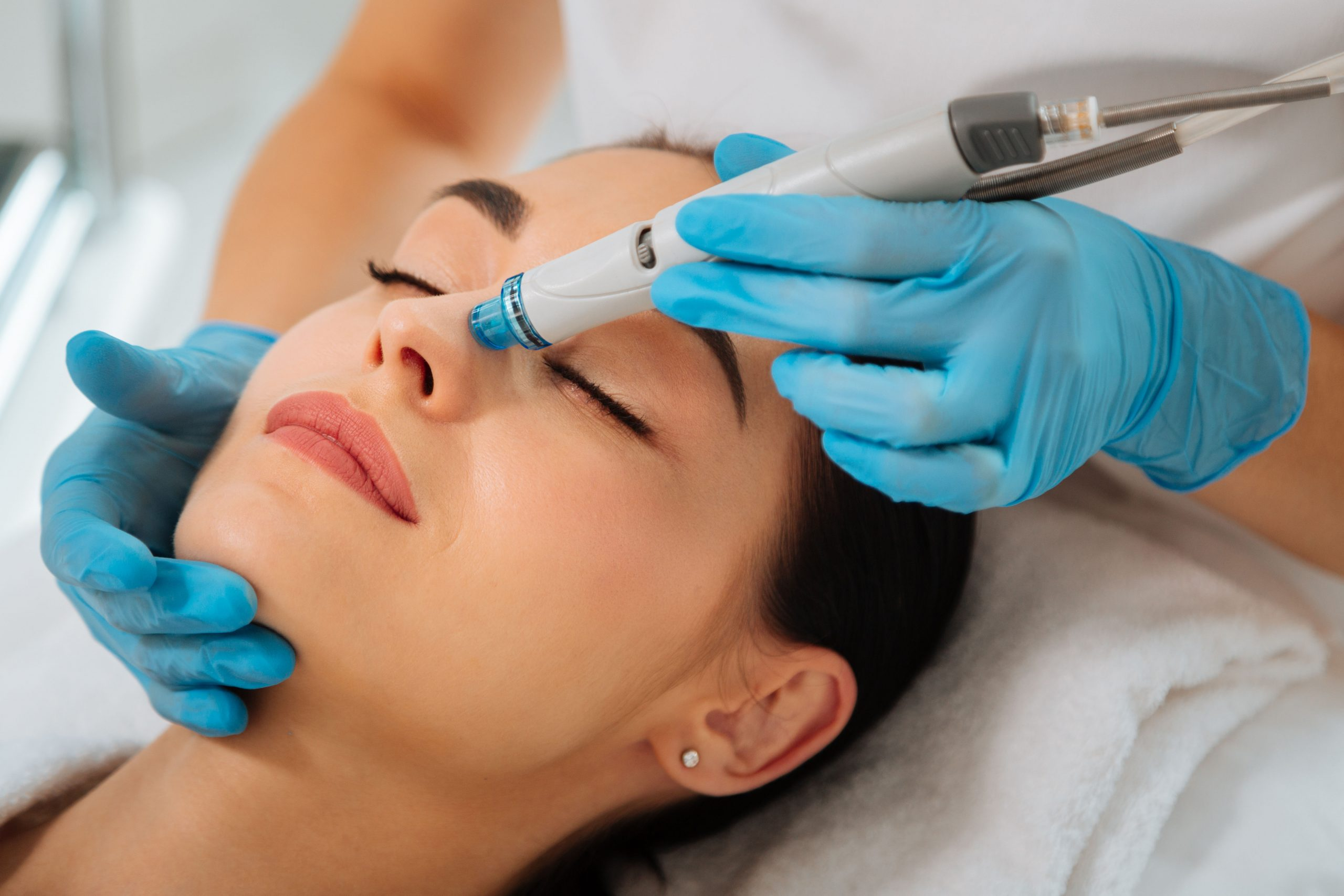 Facial,Procedure.,Delighted,Nice,Woman,Lying,On,The,Medical,Bed