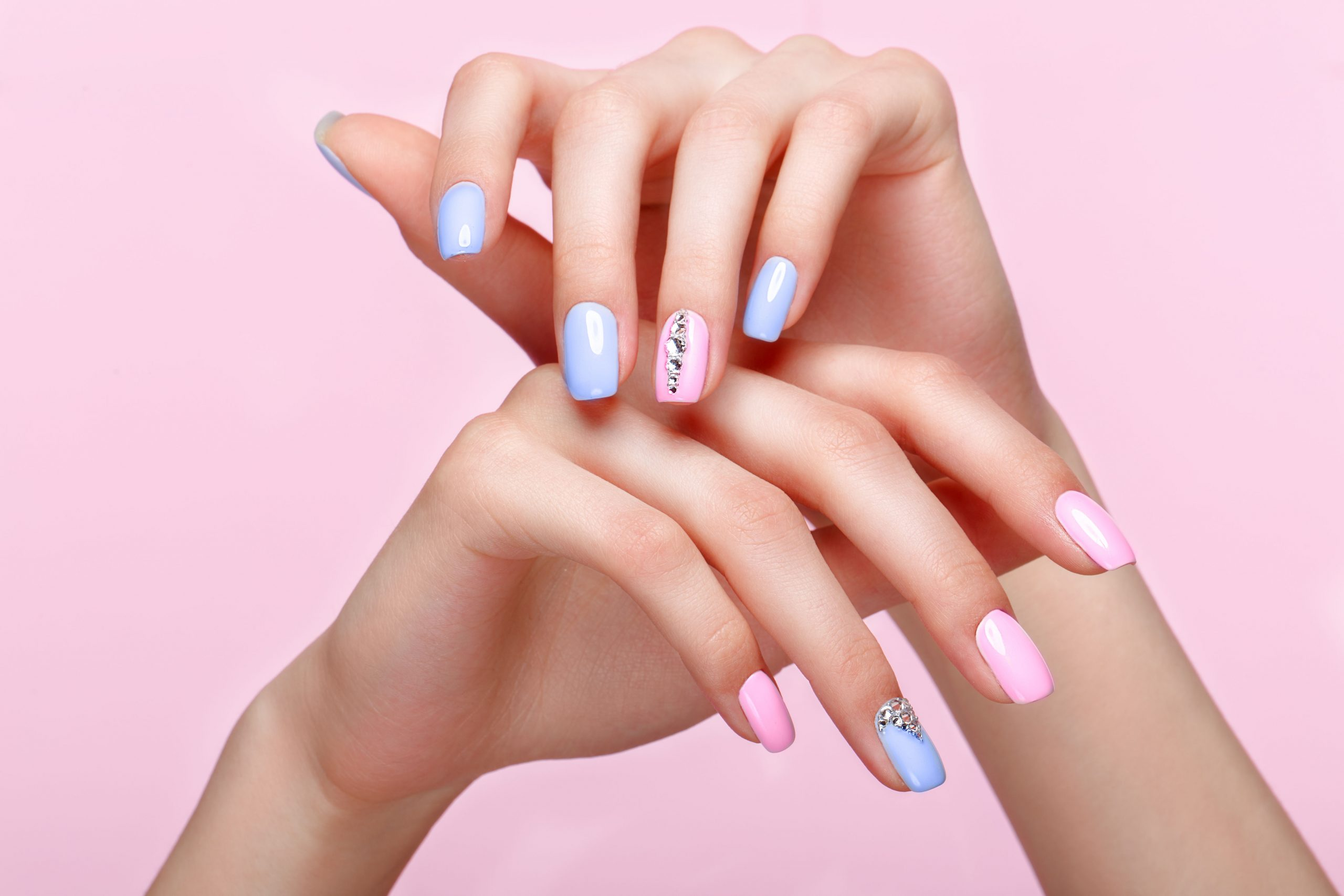 Beautiful,Pink,And,Blue,Manicure,With,Crystals,On,Female,Hand.